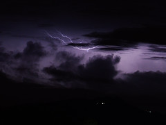 Lightning (Mark V.I) Tags: nikon nikkor 55300 longexposure lightning lightningbolt light clouds night nightshot electricity electricidad electricalstorm tormentaelectrica relampagos mountain trees arboles city ciudad cielo nubes purple composite photoshop