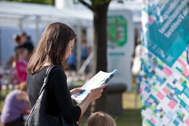Reading brochure in the sunshine
