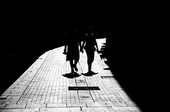 stay in the light (Brendan  S) Tags: barcelona street light shadow people love dark hope hands couple shadows friendship time silhouettes tranquility streetlife sombra streetscene lovers shade future trust damage times past loved barrio stay catalan calles patience gotico companionship barcelonastreets stayinthelight barriogoticobarcelona livelearnlove rebelsab brendan loverswalkingtogether barcelonasilhouettes