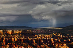 Sunset desert rain... (Robyn Hooz) Tags: park sunset usa cloud storm rain canon wonder shower eos utah is tramonto nuvola desert natural canyon bryce pioggia deserto tempesta draught siccit 70300l