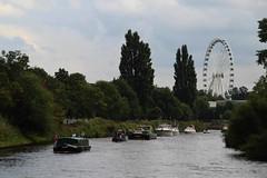 York flotilla and York wheel (nican45) Tags: york slr wheel festival canon river boat flag yorkshire sigma ferris dslr bigwheel ouse 18200 waterway bunting flotilla 18200mmf3563dcos festivaloftherivers eos600d york800