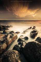 V N Gaia (Raul Nunes) Tags: sea sun clouds rocks waves slowshutter