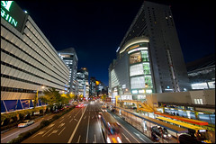 Between Hanshin and Daimaru (Eric Flexyourhead) Tags: road street city urban motion blur japan night buildings evening movement cityscape traffic departmentstore  osaka bluehour kansai umeda hanshin kitaku  daimaru  osakashi   olympusep1 panasoniclumix714mmf40