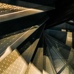 Abstract.... (+Pattycake+) Tags: rubber shadow blue contrast texturesstainlesssteel stairs staircase spiral sunlight gold abstract twist metal