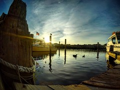 Sunset on My Heart (AngelBeil) Tags: goro abners crabhouse goodbyes sunset boardwalk pier ducks flag