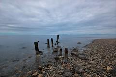 wastin' time (RhinoSkin) Tags: pilings beach cobble sea inside passage cloud british columbia