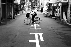 In balance (pascalcolin1) Tags: japan tokyo japon quilibre balance vlo bike parapluie umbrella photoderue streetview urbanarte noiretblanc blackandwhite photopascalcolin