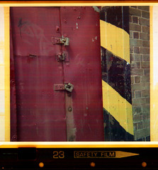 red, yellow and black (pho-Tony) Tags: 126 kodakinstamatic177x 28mmx28mm instamatic cartridge obsolete 28mm cassette c26 square klick 100xd 24 expired 1990 rollei c41 kodak 177x