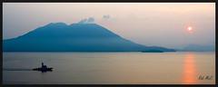 Mt Sakurajima Sunrise (Rob McC) Tags: japan mountain volcano sakurajima seascape boat ship sunrise twighlight tranquil peaceful dawn waterfront