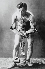Publicity Photo of Handcuff King Harry Houdini (ca. 1902). (lhboudreau) Tags: magic conjuring magician conjurer trick tricks houdini harryhoudini illusionist escapeartist legerdemain handcuffking thehandcuffking handcuff handcuffs publicityphoto publicityphotographs 1902 younghoudini theoriginal publicityphotograph illusionists escapologist stuntperformer chains locks shackles muscular man legshackles escape escapist escapology