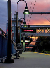 Sunset at the Platform (Bob Gundersen) Tags: bobgundersen gundersen robertgundersen nikon nikoncamera nikond5000 d5000 guilford ct conn connecticut connecticutscenes newengland usa tracks train trainstation amtrak railroad rail sunset sun dark sign town infrastructure outside outdoor exterior interesting image orange photo picture places scenes shots shoreline scene architecture whitfieldstreet engineering red utility building dusk flickr catchycolors explore