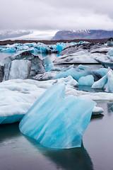 Icebergs Everywhere (Kirk Lougheed) Tags: breiamerkurjkull iceland icelandic jokulsarlon jkulsrln glacier iceberg lagoon lake landscape outdoor overcast proglaciallake sky water