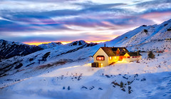 A Warm Hut On Coronet Peak (Stuck in Customs) Tags: newzealand queenstown stuckincustomscom treyratcliff treyratcliffcom ratcliff trey southisland dailyphoto horizontal colour color day inverted mountain hdr hdrphoto rr grass water sky snow blue white green black rock sony 2016 p2016 reflection pond coronet skifield outside outdoor outdoors hill landscape mountainside view range southernalps piste sport daily dusk sunset night nighttime hut lodge chalet glowing pink grey yelllow purple fujifilm xpro2 august