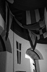 (The New Motive Power) Tags: above roof shadow sea blackandwhite brick abandoned wall contrast dark glow moody fort military victorian arc arches flags historic fabric isleofwight solent portsmouth curve fortress derelict nomansland defence doorways draped canon7d