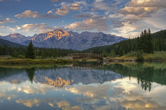 Evening Solitude (dbushue) Tags: bridge light mountains clouds reflections evening pond nikon solitude peaceful calm peaks albertacanada 2012 banffnationalpark coth cascadeponds supershot absolutelystunningscapes d7000 damniwishidtakenthat coth5 photocontesttnc12 dailynaturetnc12 tpslandscape