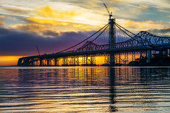 A New Dawn - San Francisco, Oakland Bay Bridge (Darvin Atkeson) Tags: sanfrancisco california morning reflection sunrise dawn oakland construction glow treasureisland suspension crane baybridge bayarea spaceshuttle flyover endeavor cantilever yerbabuenaisland darvin erectorset atkeson darv liquidmoonlightcom lynneal