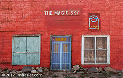 The Magic Sky (Jim Frazier) Tags: plaza old trip travel windows vacation brown newmexico detail art heritage history lines architecture buildings beige nikon doors pov decay tan structures landmarks sunny august bluesky tourist symmetry architectural historic study adobe worn shutters historical symmetrical weathered taos traveling nm perpendicular centered stucco q3 attraction 2012 rundown ranchodetaos lightroom horizontallines historicdistrict headon verticallines d90 nationalregisterofhistoricplaces centralperspective nrhp ldoctober ©jimfraziercom ld2012 20120803westernroadtrip 20120810taoschurch wmembed ranchodetaosplaza