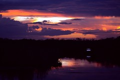 Sign (PelicanPete) Tags: blue light sunset reflection sign river dark intense colorful glow unitedstates florida wildlife smooth vivid peaceful bluesky calm landing national poles cloudscape puffyclouds refuge southflorida afterglow fridaynight loxahatchee palmbeachcountyflorida canoepath