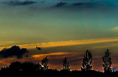 Backlight (Eduard van Bergen) Tags: chopper helicopter light evening colors flying pilots cockpit propeller sony ilce alpha sigma art 60mm 28 dying day sun clouds roofs trees hovering night flight officer uniform police trooper state rotor test search party airplane departures arrivals homing home wind high chemtrail gendarmerie lost fire hemel sky himmel feu