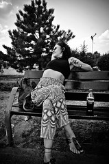Stretch (stimpsonjake) Tags: nikoncoolpixa 185mm streetphotography bucharest romania city candid blackandwhite bw monochrome stretch woman youngwoman bench park piataunirii
