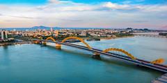 Dragon Bridge (free3yourmind) Tags: dragon bridge danang vietnam river clouds blue sky city
