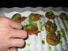 Shrimp lollipops with cashew-cilantro pesto