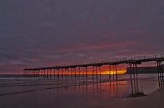 Red dawn at Saltburn. (paul downing) Tags: summer sunrise pier nikon northsea saltburnbythesea pd1001 d7000 pauldowning pauldowningphotography