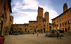 San Gimignano has retained its ancient atmosphere and appearance (Bn) Tags: old city light sunset red summer sky italy orange sunlight house man colour tower colors sunshine wall fairytale naked high topf50 san artist italia ray glow berries estate gimignano heart wine small hill inspired dry ground vessel exhibit unesco hills vineyards valley tuscany grapes villa chianti belle vista strong layers cypress summertime wildflowers taste roads sangimignano middle antony product viewpoint ages fruity sculptor rubby gormley vino torri tuscan delle cultivated hillsides harmonious 50faves piazzadellacisterna provinceofsiena