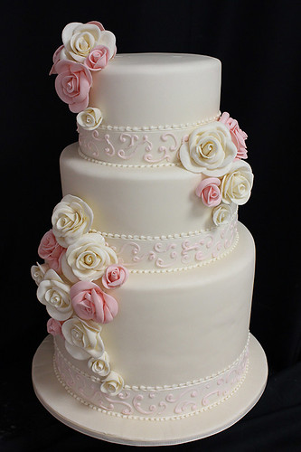 Scrollwork Ribbon and Sugar Roses Wedding Cake