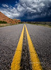 Desert Storm [Explored 10/1/2012] (dfikar) Tags: road storm newmexico yellow bravo unitedstates desert explore getty rainstorm redrocks stormysky stormclouds abiquiu gallina lateafternoonlight pentaxk5 highdesertlight