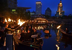 Christina Paxson, President of Brown University, receives the flame to lite WaterFire