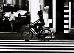 Black and White Cyclist Amsterdam (el_boberino) Tags: street city blackandwhite holland netherlands monochrome amsterdam cycling nikon panning nederlands travelphotography nikon3200 d3200 flickrtravelaward