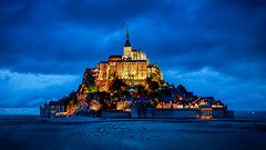 Mont St Michel (adrianchandler.com) Tags: france mont architecture city coast coastal exterior french medievel montsaintmichel mount normandy outdoor rock seaside town saint bluehour night