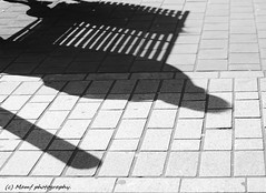 Shadow. (MAMF photography.) Tags: art arty blackandwhite blackwhite britain bw biancoenero beauty blancoynegro blanco blancoenero city dark england enblancoynegro flickrcom flickr google googleimages gb greatbritain greatphotographers greatphoto inbiancoenero image leeds ls1 leedscitycentre citycentre mamfphotography mamf monochrome nikon noiretblanc noir negro north nikond7100 northernengland onthestreet photography pretoebranco photo road schwarzundweis schwarz street seat town uk unitedkingdom upnorth westyorkshire yorkshire zwartenwit zwartwit zwart
