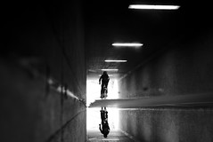 Into the light (maekke) Tags: zrich reflection puddlegram cycling bicycle man tunnel underground urban bw pointofview pov noiretblanc highcontrast fujifilm x100t 2016 switzerland ch streetphotography