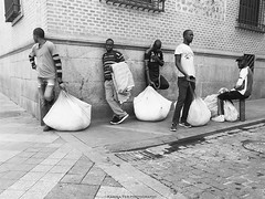 Madrid, 2016 (A-cat-and-a-half) Tags: streetvendors harsh immigrants illegals sacks street candid choreography rap hiphop music blackandwhite madrid spain life urban criminal tough waiting