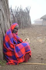 Keeping Out the Cold (fuzzball5) Tags: 2016africatanzania maasai village ngorongoro crater shuka blanket chief
