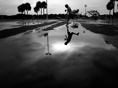 (sparth) Tags: blackandwhite reflection blackwhite kid jump child noiretblanc florida august enfant ricoh saut spacecenter 2012 mirrir noirblanc grd grd4 ricohgrdiv grdiv ricohgrd4
