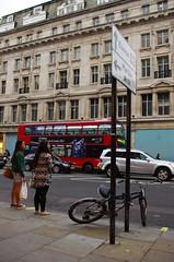 A Bike Waits (DJ Greer) Tags: road street england people london bike bicycle lock scene busy rush hour oxford locked