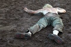 Muddy hell  Rob Watkins 2012 (Aland Rob) Tags: music man green face festival wales hair naked fan long alone mud skin boots top down dirty covered tired collapse blonde half shorts welsh brecon sprawled lying muddy collapsed crickhowell glanusk
