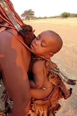 Going around (vittorio vida) Tags: africa travel boy portrait girl children child tribal tribe ethnic namibia himba