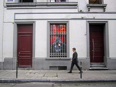 people from brussels (maximorgana) Tags: street door red brussels white black window stairs walking handle belgium gorilla teeth steps tie plate suit rb rbw fang barandilla bolardo