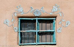 Decorated Window (Jim Frazier) Tags: plaza old trip travel windows vacation brown newmexico detail art heritage history lines architecture buildings beige nikon doors pov decay tan structures landmarks sunny august bluesky tourist symmetry architectural historic study adobe worn shutters historical symmetrical weathered taos traveling nm perpendicular centered stucco q3 attraction 2012 rundown ranchodetaos lightroom horizontallines historicdistrict headon verticallines d90 nationalregisterofhistoricplaces centralperspective nrhp ldoctober ©jimfraziercom ld2012 20120803westernroadtrip 20120810taoschurch wmembed ranchodetaosplaza
