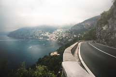 The Road to Positano (QuikSink) Tags: ocean road trip blue italy white holiday black green leaves tarmac stone buildings boats town italia vespa cyan scooter cliffs adventure positano below ripples hillside rippling lowcontrast faraway cliffside canon2470mm canon5dmkiii june2012