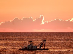 Electric Silver Lining (mikecogh) Tags: glenelg sunset clouds edge glow horizon dredge silverlining