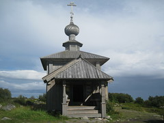 a church (VERUSHKA4) Tags: white sea church kirchen travel historic sky vue view nature religion ciel verdure green grey ancient summer august album solovki karelia island russia canon zayatskiy croi stairs wooden cupol arcitecture landscape door roof stone