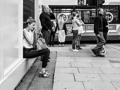 Northern Quarter #114 (Peter.Bartlett) Tags: manchester bag noiretblanc women standing sitting unitedkingdom woman people walking corner olympuspenf wall urbanarte urban cellphone niksilverefex lunaphoto man girl streetphotography candid uk m43 microfourthirds mobilephone bw peterbartlett sign blackandwhite city men makeup mirror bus