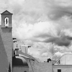 Ravenous souls. (AMCH Photography) Tags: light sky blackandwhite bw tower art film church lines mxico architecture clouds landscape mexico photography cityscape bell kodak geometry empty grain shapes dome lonely void tlaxcala huamantla amchphotography artistsontumblr alejandromcamposherrera