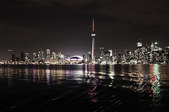 my city (Morningdew Photography) Tags: pink blue light red white toronto ontario canada black building green water skyline night plane canon silver buildings dark grey lights evening exposure cntower waterfront gray financialdistrict on torontoislands wardsisland rogerscentre torontoislandairport alienskin ef24105l morningdewphotography t1i itsgrainyiknow