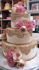 3-tier Wicked Chocolate wedding cake iced in caffe latte chocolate ganache, with piped brown crochet-style lace designs, fresh pink & antique style roses (Charly's Bakery) Tags: birthday wedding cake corporate town chocolate novelty wicked bakery cape charlies speciality charleys charlys